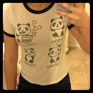 This is a juniors crop-top with a panda on it.